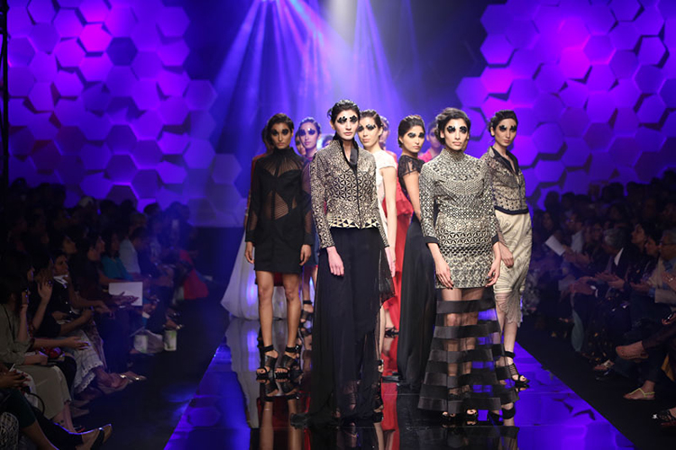 There are three reasons why you will walk away from Rahul Mishra's show pleasantly pleased----he immediately gives credit to his wife for his success, tells you that he has abandoned his 'safety net' of textiles, and introduces you to the next big thing; caterpillar sleeves.